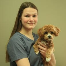 Chanelle holding a dog