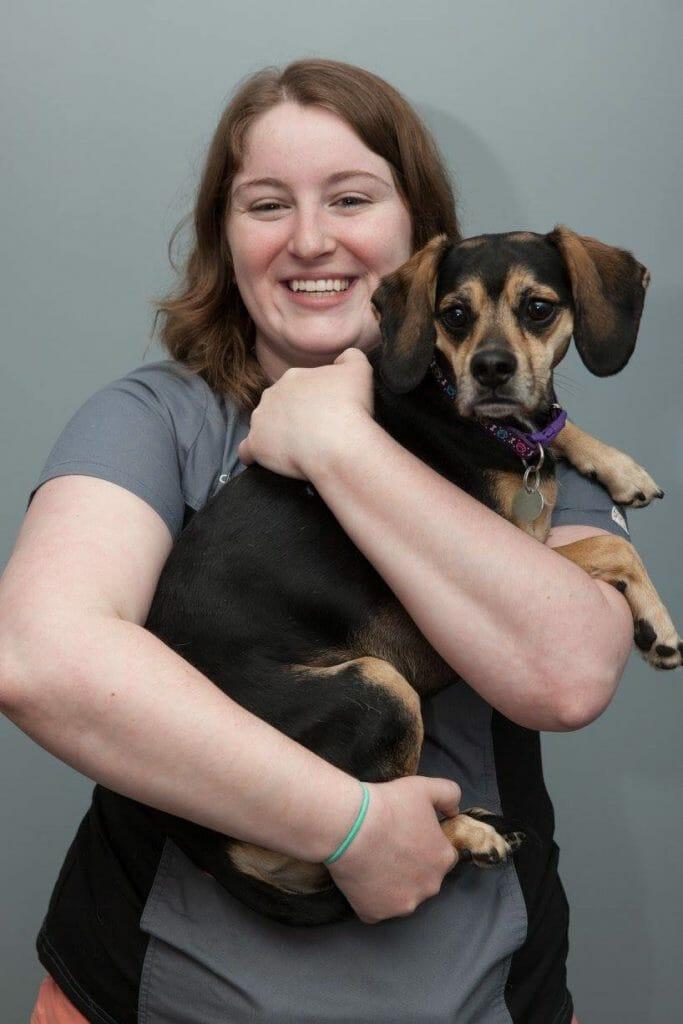 Francheska holding a dog
